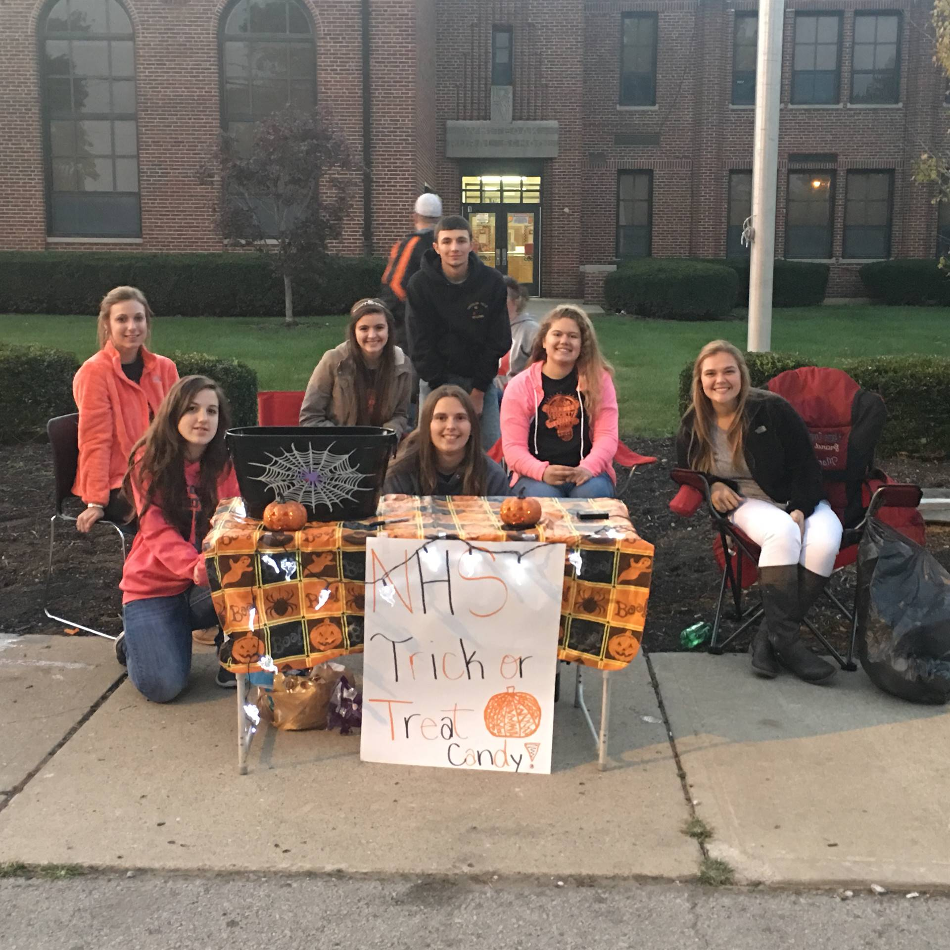 NHS handing out candy during Trick or Treat